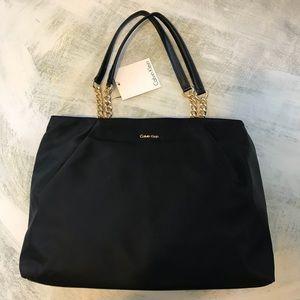 ba86079b9f Calvin Klein Bags - Calvin Klein Classic Black Bag With Gold Accents